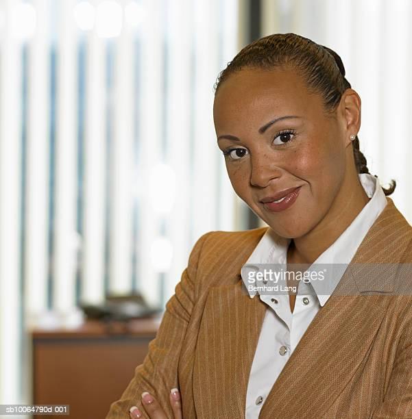 Mid adult businesswoman in office, portrait