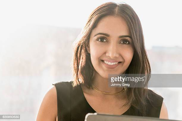mid adult businesswoman smiling towards the camera - 35 39 years stock pictures, royalty-free photos & images
