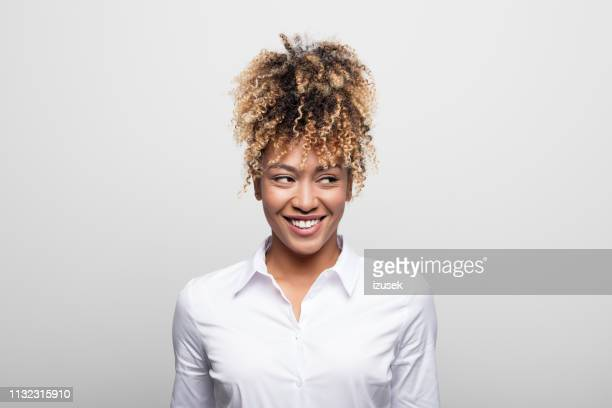 mid adult businesswoman smiling while looking away - sideways glance stock pictures, royalty-free photos & images