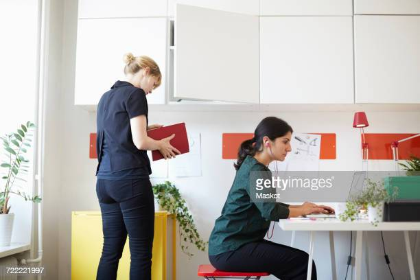 Mid adult businesswomen working in office