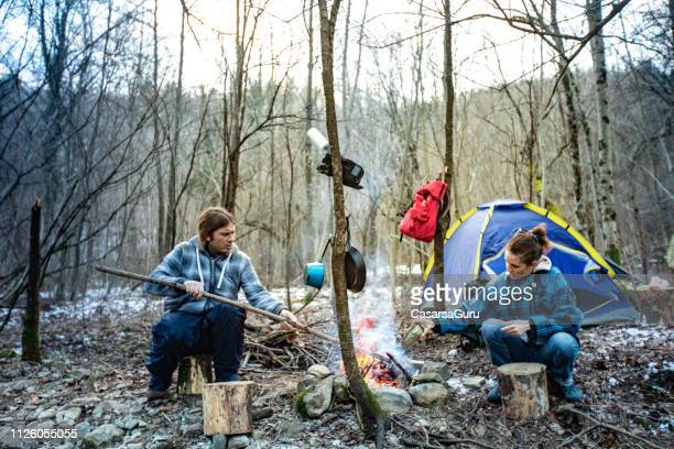 mid adult couple camping in winter together - hillbilly stock pictures, royalty-free photos & images