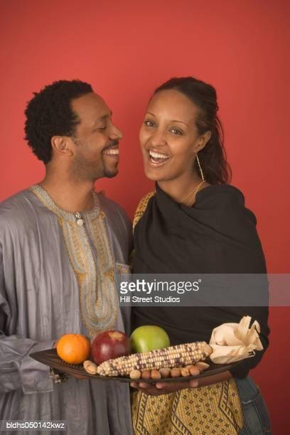 Mid adult couple celebrating Kwanzaa