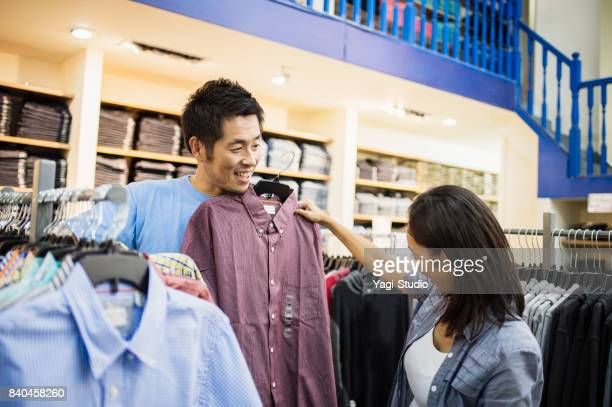 Mid adult couple choosing clothes