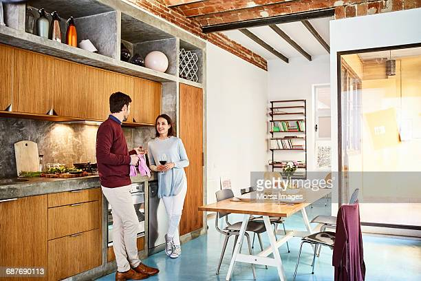 Mid adult couple communicating in kitchen