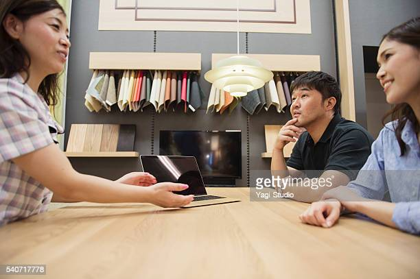 Mid adult couple consulting the staff in Interior shop.