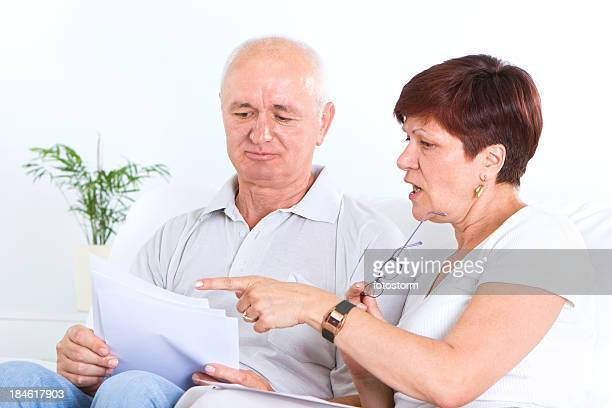 Mid Adult Couple Doing Paperwork