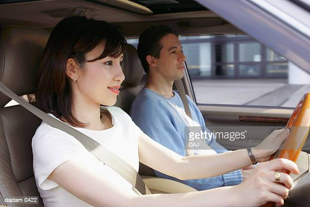 Mid Adult Couple Driving