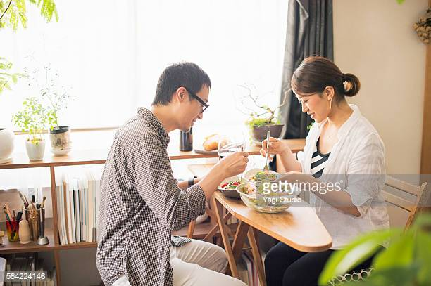 mid adult couple eat lunch with wine - 食事 ストックフォトと画像