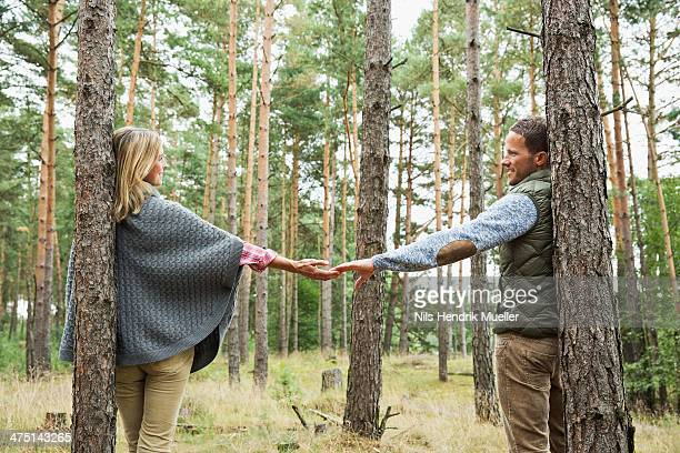 Mid adult couple holding hands in forest