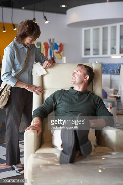 mid adult couple in a store - reclining chair stock photos and pictures
