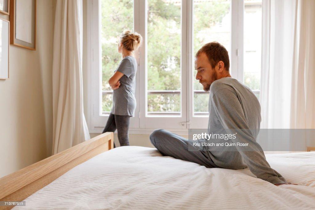 Mid adult couple in bedroom, having disagreement : Stock Photo