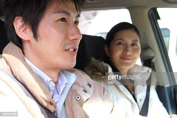 Mid adult couple in the car, smiling