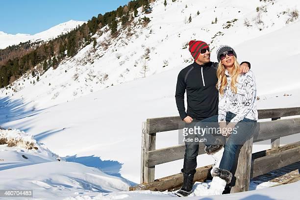 Mid adult couple leaning against fence, Obergurgl, Austria