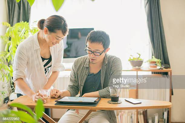 Mid adult couple looking at a digital tablet