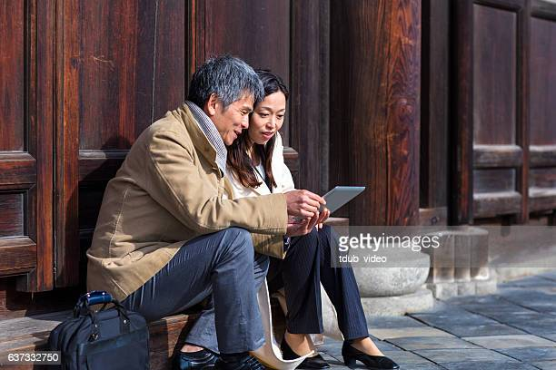 Mid adult couple looking at a digital tablet together