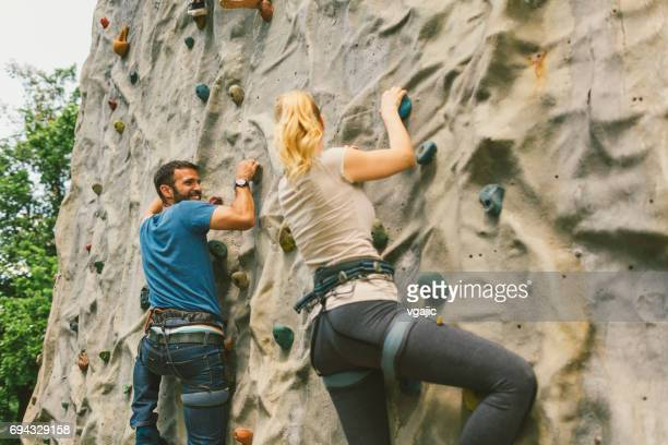 Mid adult couple on free climbing