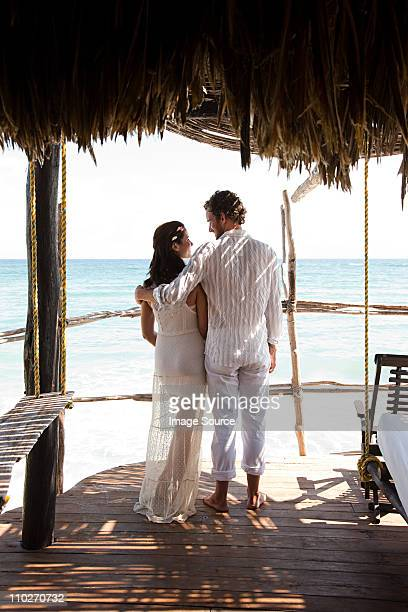mid adult couple on vacation in beach hut - honeymoon stock pictures, royalty-free photos & images