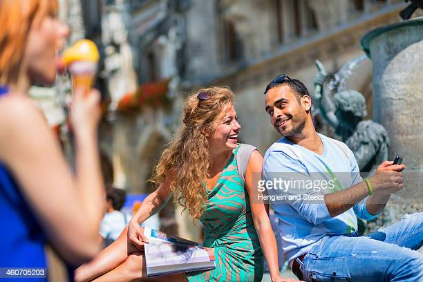 mid adult couple on vacation - marienplatz stock pictures, royalty-free photos & images