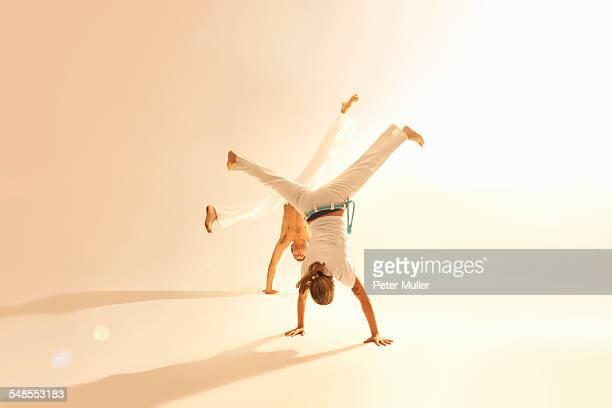 mid adult couple practising capoeira - capoeira imagens e fotografias de stock