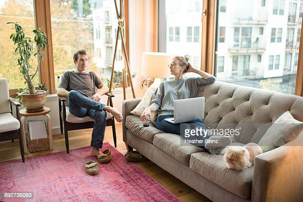 Mid adult couple relaxing in living room