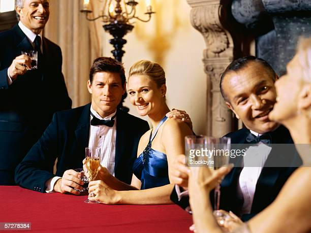 Mid adult couple sitting and holding champagne flute