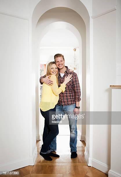 Mid adult couple standing in doorway