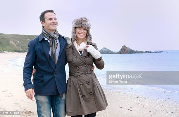 Mid adult couple strolling on beach, Thurlestone, Devon, UK