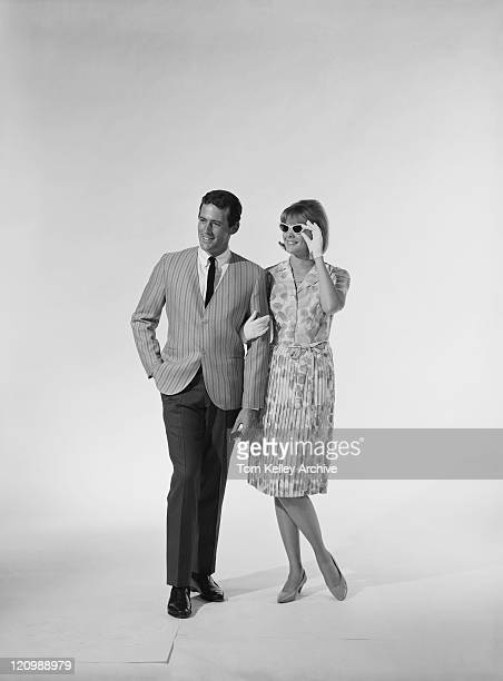 Mid adult couple walking on white background