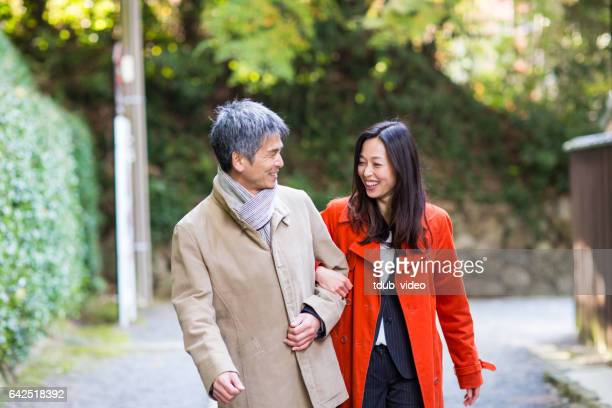 mid adult couple walking together - mid adult couple stock pictures, royalty-free photos & images