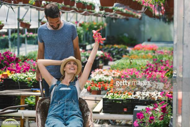 Mid adult couple working in botanical garden
