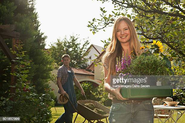 Mid adult couple works together in the garden, Munich, Bavaria, Germany