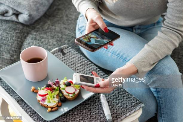 mid adult diabetic woman having breakfast at home - diabetes stock pictures, royalty-free photos & images