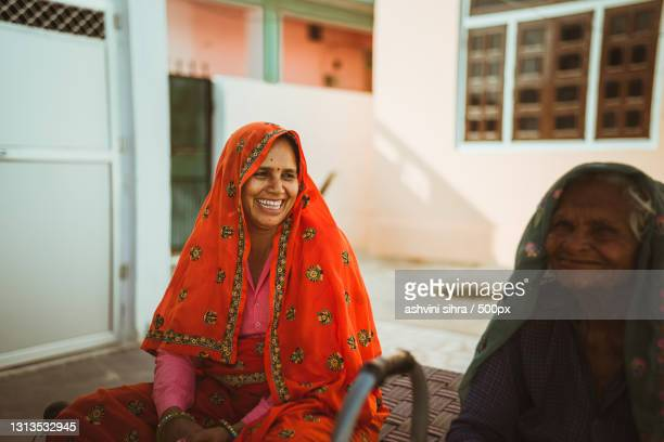mid adult indian woman smiling and laughing with elderly mother,india - images stock pictures, royalty-free photos & images