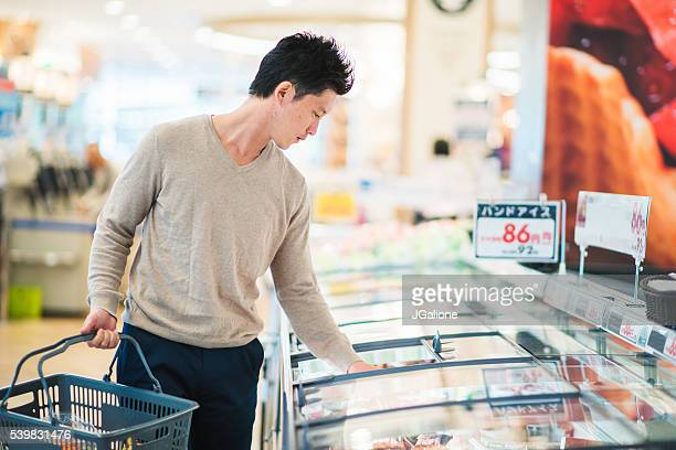 Mid adult male grocery shopping