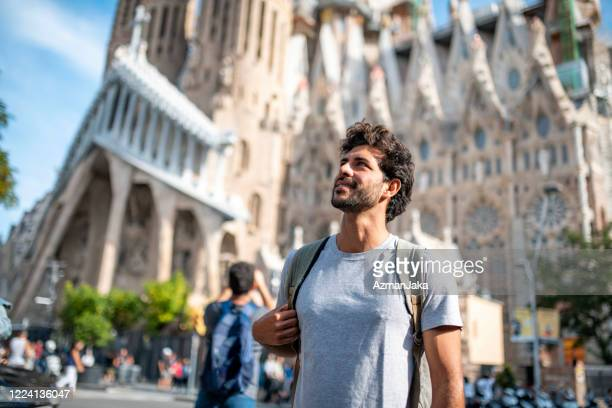 mid adult male tourist with smart phone in barcelona - barcelona spain stock pictures, royalty-free photos & images