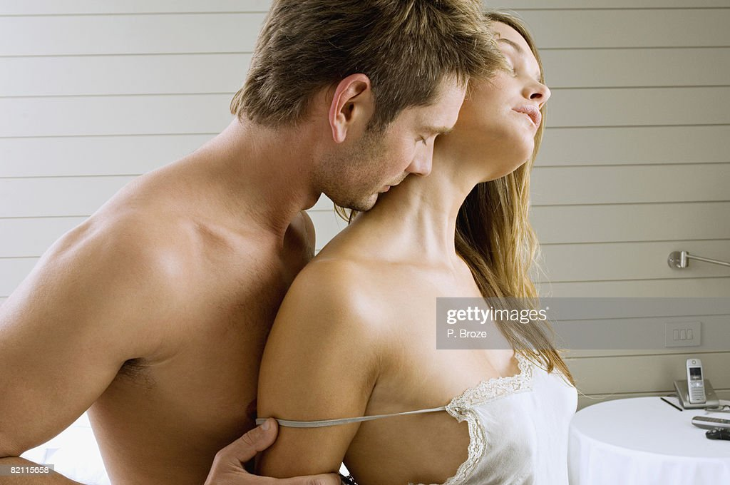 Mid adult man and a young woman romancing : Stock Photo