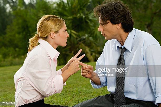 Mid adult man arguing with a young woman