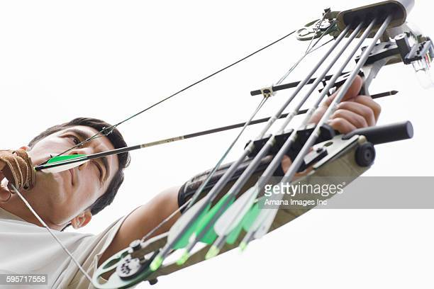 Mid Adult Man Arrow Shooting