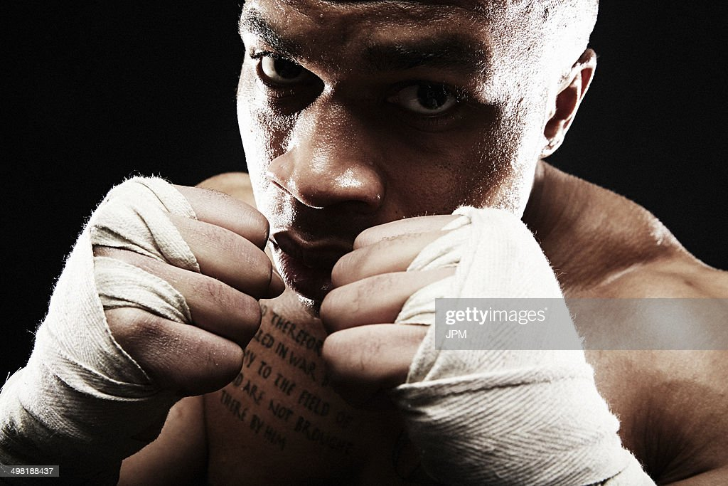 Mid adult man boxing, close up : Stock Photo