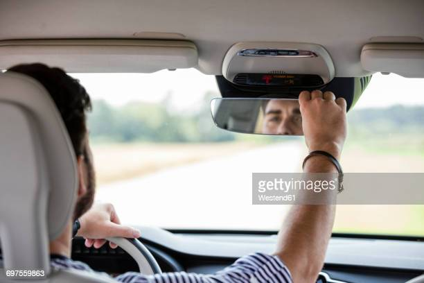 Mid adult man driving in car