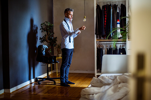 Mid adult man getting ready for office - gettyimageskorea