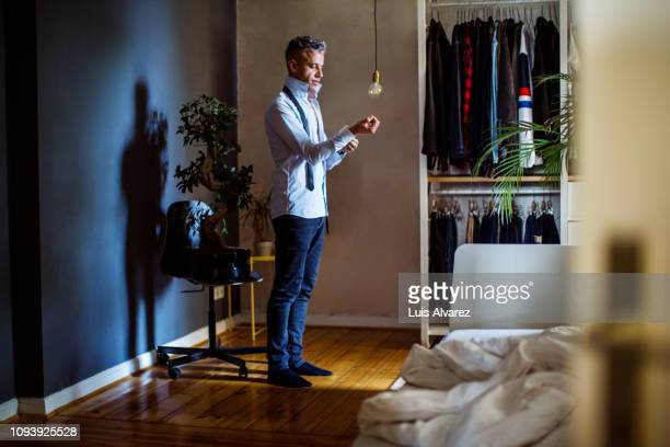 Mid adult man getting ready for office