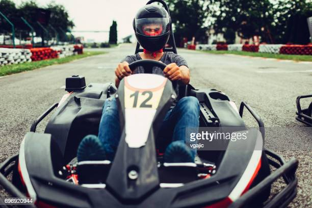 mid adult man go-karts - go cart stock pictures, royalty-free photos & images