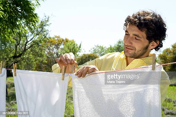 Mid adult man hanging laundry in garden