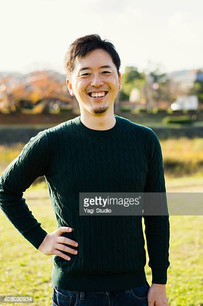 mid adult man having a good time in outdoors - 30代 ストックフォトと画像