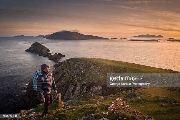 Mid adult man, hiking, Slea head, County Kerry, Ireland
