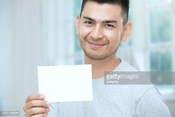 mid adult man holding a blank card - blank sign stock photos and pictures