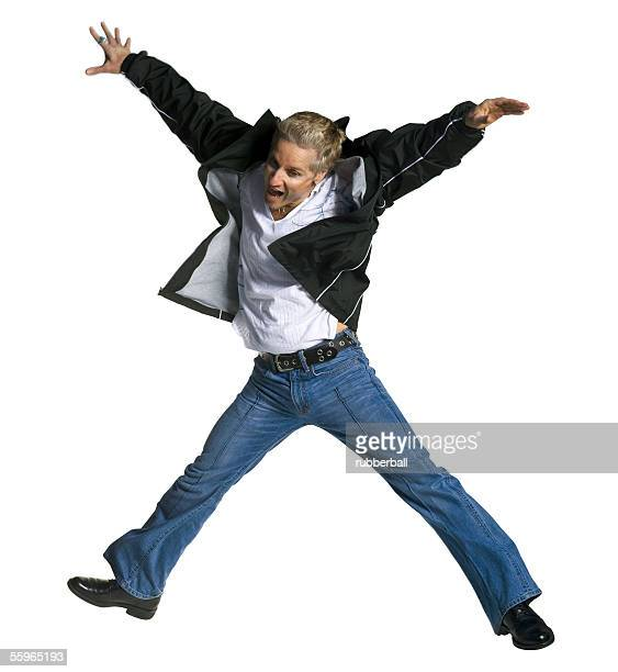 mid adult man jumping - legs spread open stock photos and pictures