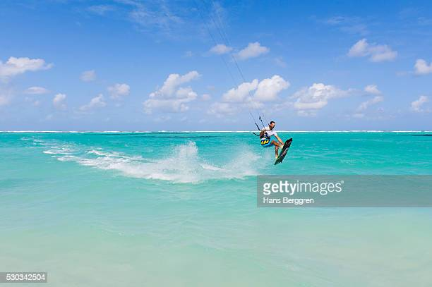 mid adult man kite surfing - kiteboarding stock photos and pictures