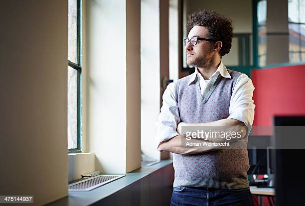 Mid adult man looking out of window